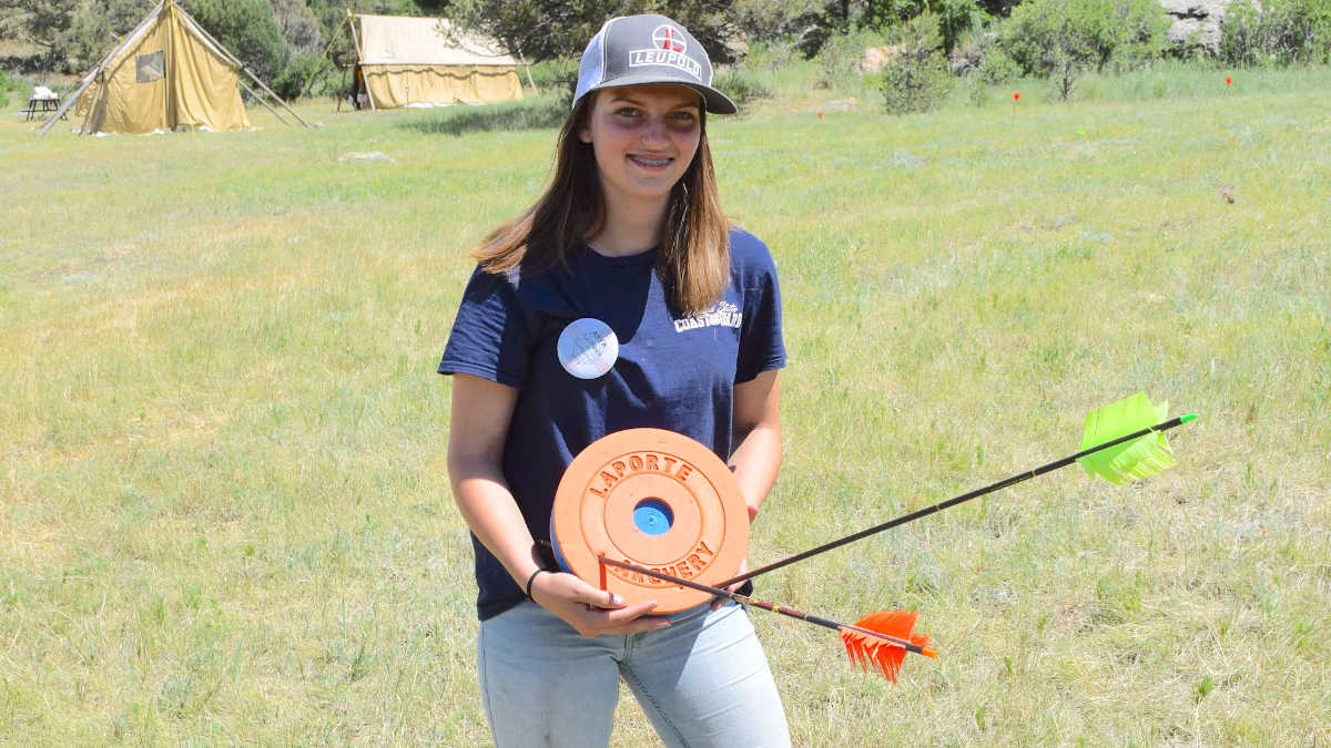Young woman showing off her archery skills at the NRA Whittington Center Adventure Camp in New Mexico