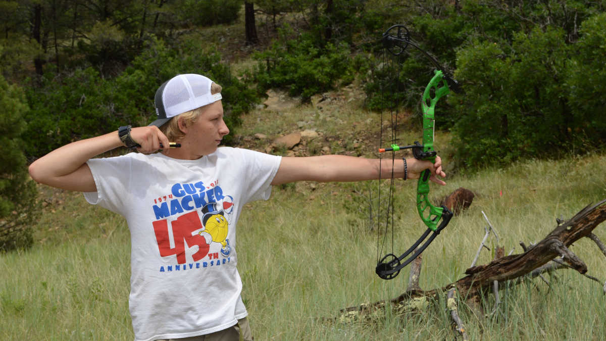 Youth shows great archery form at the NRA Whittington Center Adventure Camp