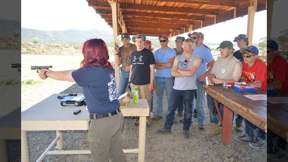 NRA Instructor showing students how to properly discharge a hand gun