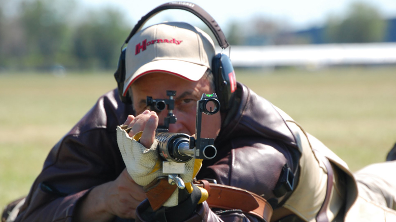 Competitor shooting a rifle